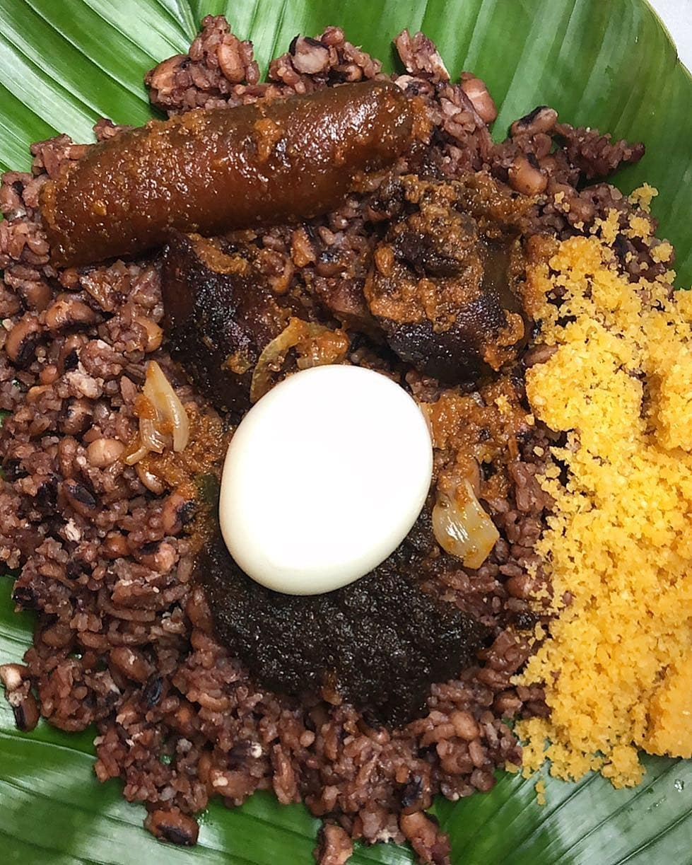 An image of a proper waakye meal with all the works.